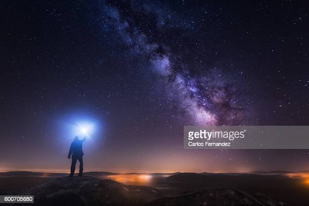 man looking up the milky way - space exploration stock pictures, royalty-free photos & images