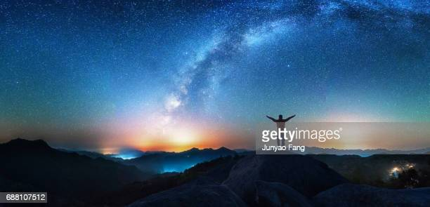 man looking up the milky way - milky way stock pictures, royalty-free photos & images