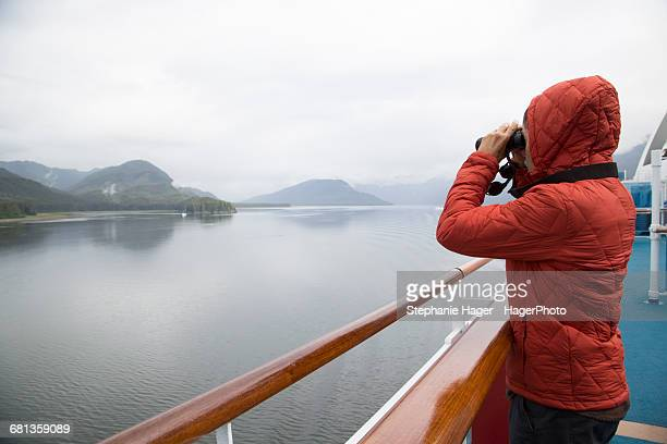 Man looking with binoculars at Glacier Bay