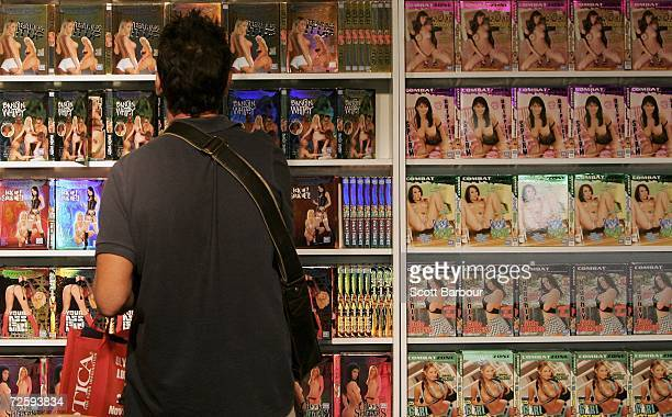 A man looks a xrated videos on display at the Erotica 2006 exhibition at Olympia November 17 2006 in London England The four day event includes...