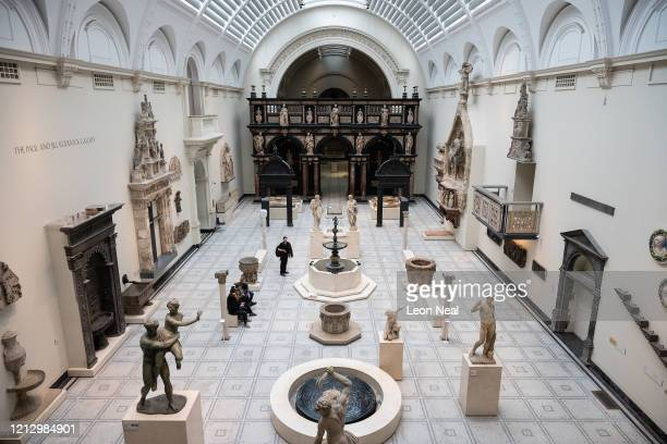 Man looks around a near-deserted gallery in the V&A Museum on March 17, 2020 in London, England. Boris Johnson held the first of his public daily...