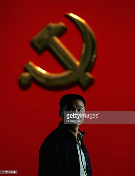 Man looks around during a visit to a Chinese Communist Party exhibtion on October 9, 2007 in Beijing, China. China's ruling Communist Party today...