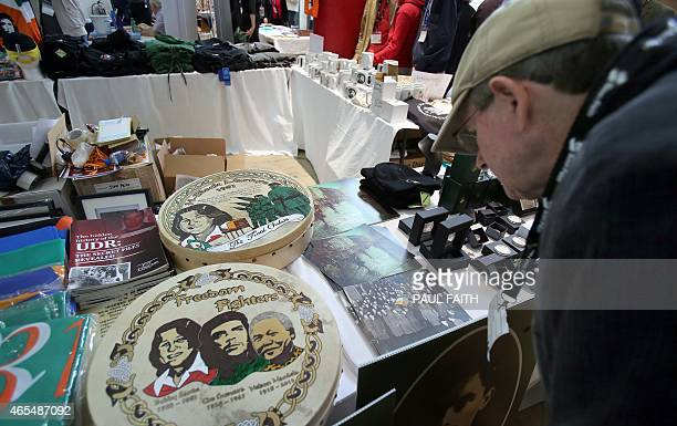 A man looks at a Bodhran an Irish Drum in memory of Bobby Sands a member of the Provisional Irish Republican Army who was the first who died on...