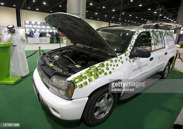 Man looks at a Chevrolet Blazer hybrid test car at a display of environmentally friendly vehicles by the Gulf Organisation for Research and...