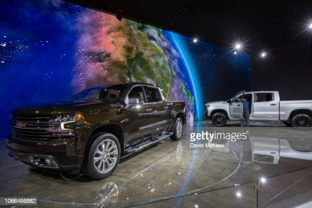 A man looks at a Chevrolet Silverado truck at the auto trade show AutoMobility LA at the Los Angeles Convention Center on November 29 2018 in Los...