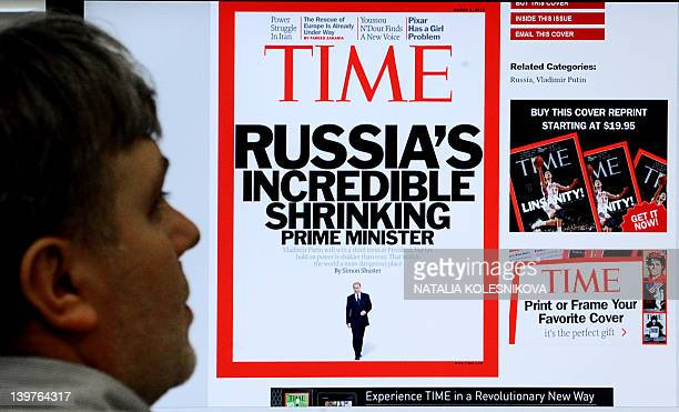 A man looks at a computer monitor displaying a web page with a front cover of the US magazine Time in Moscow on February 15 2012 Vladimir Putin's...