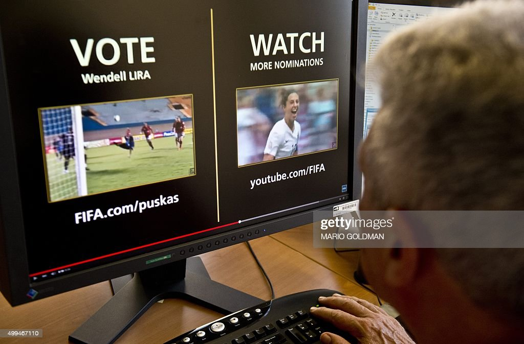 A man looks at a computer screen displaying the FIFA web page where people from around the globe can vote their favorite candidate for the Puskas Award -greatest goal of the year- in Montevideo on December 1, 2015. Brazilian Wendell Lira scoring for Brazilian regional league Goianesia competes with Argentinian FC Barcelona forward Lionel Messi and Italian AS Roma Alessandro Florenzi after their goals were chosen as finalists among thousands.