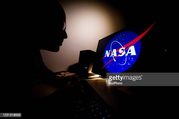 Man looks at a computer screen with a Facebook logo in Warsaw, Poland on February 21, 2021. NASA will air live coverage of spacewalks from the space...