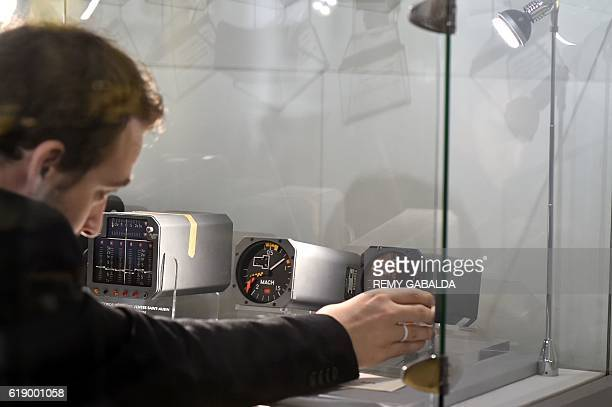 A man looks at a Concorde flight instrument exhibited at the Saint Aubin Auction House in Toulouse on October 28 ahead of an auction of Concorde...