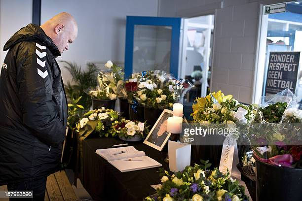 Man looks at a condolence book in memory of linesman Richard Nieuwenhuizen at the clubhouse of Dutch football club SC Buitenboys in Almere, on...