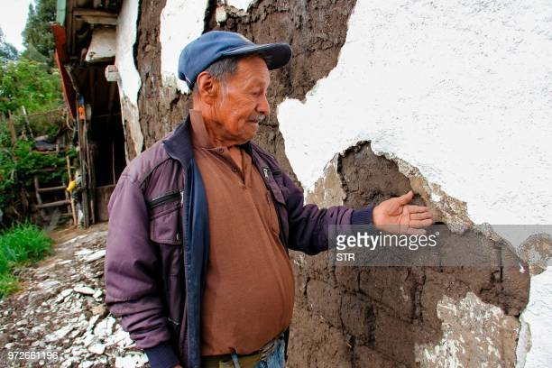 A man looks at a crack in his house affected by an earthquake on June 12 in Briceno Narino department Colombia A shallow earthquake measuring 43...