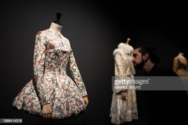 A man looks at a creation by Spanish designer Leandro Cano during the exhibition Modus on December 4 2018 in Madrid On display at Sala Canal de...