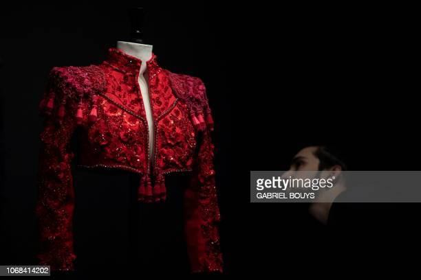 A man looks at a creation by Spanish designer Lorenzo Caprile part of the exhibition Modus on December 4 2018 in Madrid On display at Sala Canal de...