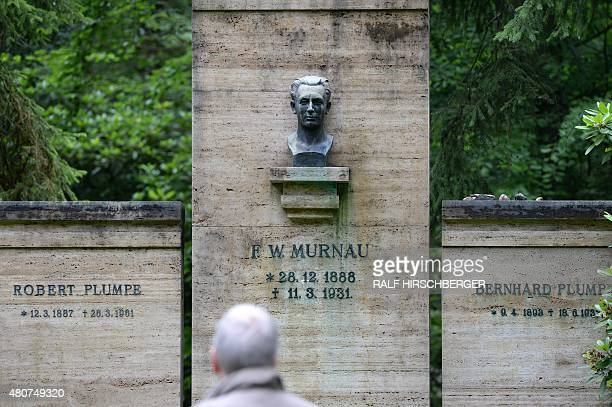 A man looks at a crypt of the Murnau and Plumpe families on July 15 2015 in Stahnsdorf Germany Grave robbers have stolen from a crypt the head of...