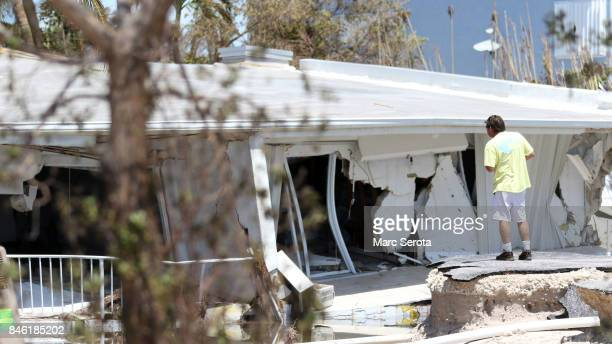 A man looks at a destroyed house following powerful Hurricane Irma on September 12 2017 in Lower Matecumbe Key in the Florida Keys Irma made landfall...