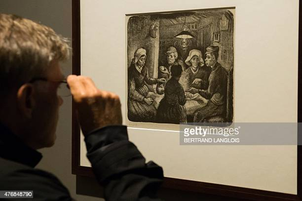 A man looks at a draw entitled 'The Potato eaters Nuenen 1885' by Dutch artist Vincent Van Gogh during the 'Van Gogh Drawings Influence and...