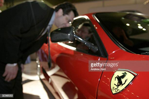 A man looks at a Ferrari 360 Modena during the Gala preview of the 2004 New York International Auto Show April 7 2004 in New York City The Gala...