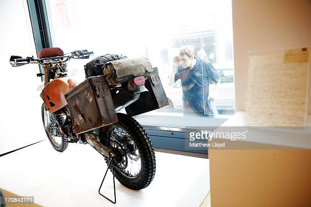 A man looks at a Honda motorcycle riden by Daniel Craig in the James Bond movie Skyfall for sale at Christie's South Kensington on June 19 2013 in...