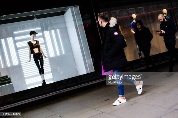 A man looks at a mannequin in a shop window on Oxford Street in London England on February 9 2019 February 15 sees the release of the first monthly...