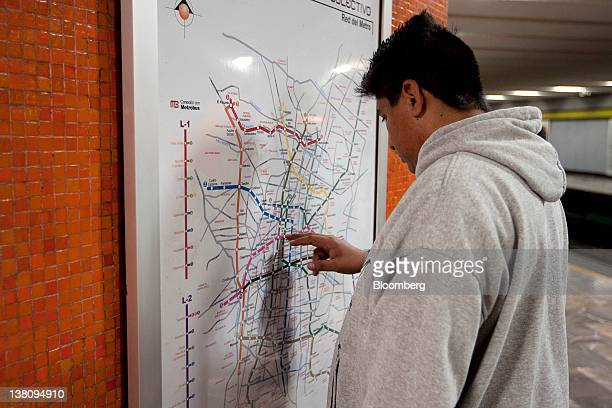 A man looks at a map of the subway system in Mexico City Mexico on Tuesday Jan 31 2012 The Mexico City Metro officially called Sistema de Transporte...