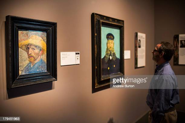 A man looks at a painting at the Detroit Institute of Arts on September 3 2013 in Detroit Michigan Detroit once known as powerhouse for creativity...