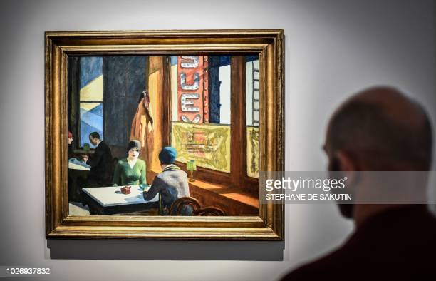 A man looks at a painting by US artist Edward Hopper named Chop Suey that is part of the Barney A Ebsworth Collection during a presentation of the...