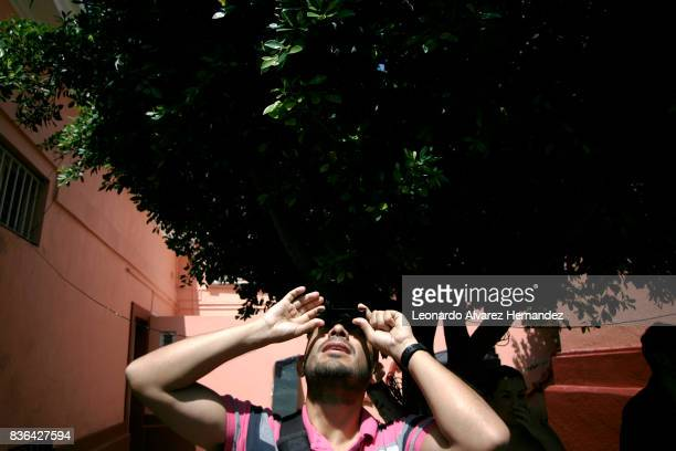 A man looks at a partial solar eclipse in the Institute of Astronomy and Meteorology at Guadalajara University on August 21 2017 in Guadalajara México