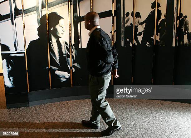 A man looks at a photograph of civil rights icon Rosa Parks at the Rosa Parks Museum October 28 2005 in Montgomery Alabama Parks who died Monday at...