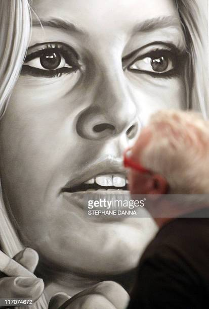A man looks at a picture depicting French model and actress Brigitte Bardot on the eve of the Brigitte Bardot's exhibition opening at the Espace...