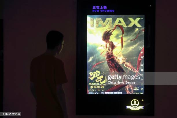 A man looks at a poster of 3D animation film 'Ne Zha' at a cinema on August 2 2019 in Taiyuan Shanxi Province of China On August 7 the box office of...