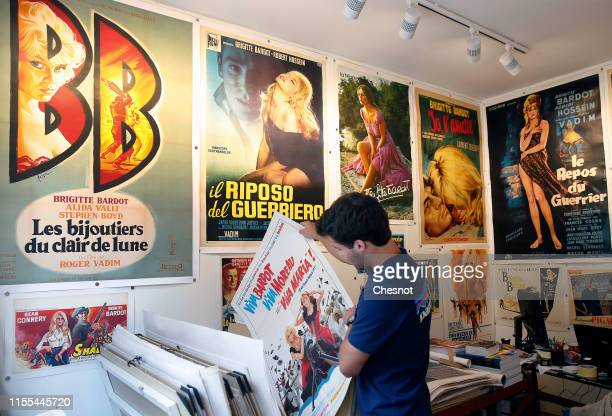 A man looks at a poster of a movie with French actress Brigitte Bardot during the exhibition The Bardot years 19521973 at Orsay Gallery on June 12...