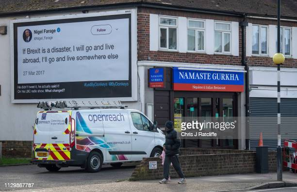 A man looks at a quote from former UKIP party leader Nigel Farage on a billboard on March 11 2019 in London United Kingdom The billboard campaign has...