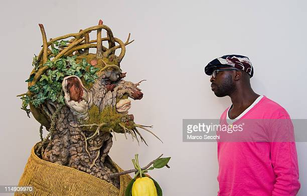 A man looks at a sculpture interpretation of Arcimboldo's Winter portrait by Philip Haas at the press preview of Ileana Sonnabend Un Ritratto...