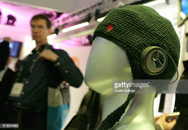 A man looks at a snowboarding hat made by Burton with Motorola Bluetooth technology is seen on display at the 2005 Consumer Electronics Show January...