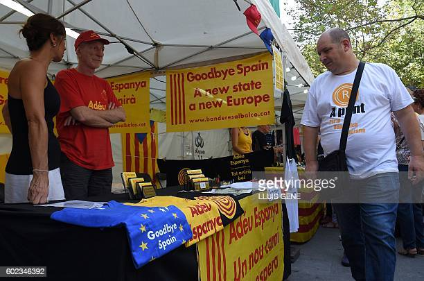 A man looks at a stand selling proindependence objects before a proindependence demonstration on September 11 in Barcelona during the National Day of...