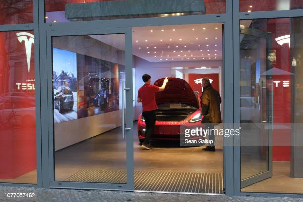 A man looks at a Tesla car at a Tesla dealership on January 4 2019 in Berlin Germany Tesla is expected to soon begin deliveries of the Model 3 in...