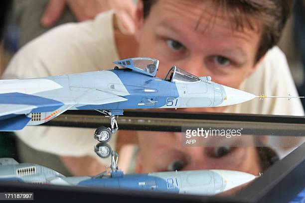 A man looks at an airplane model at the modelmaking exhibition Modellbrno in Brno Czech Republic on June 22 2013 The exhibition is the largest oneday...