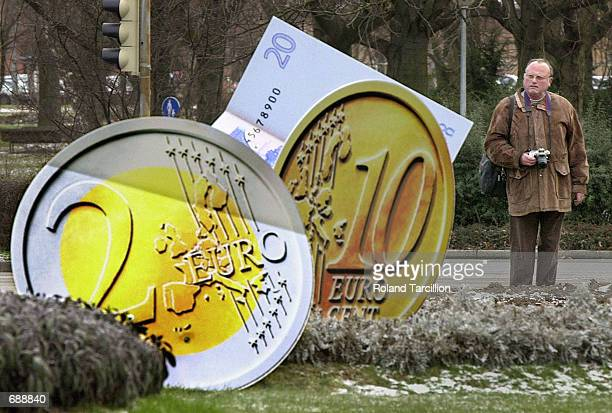 A man looks at an art installation of Euro Currency December 22 2001 in Ludwigsburg Germany On January 1 2002 12 European countries will adapt the...