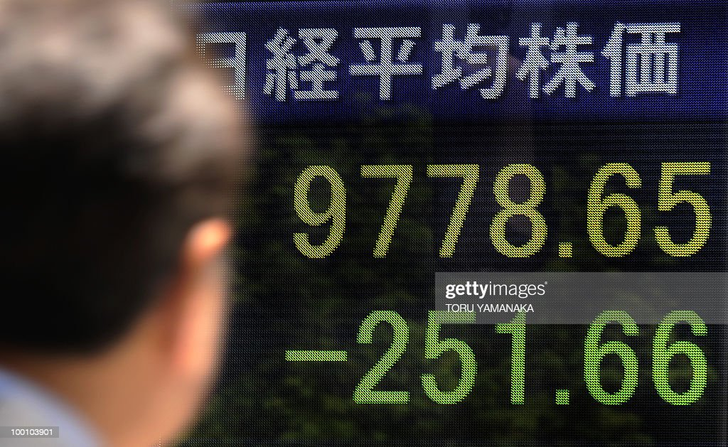 A man looks at an electric quotation board flashing the Nikkei key index of the Tokyo Stock Exchange (TSE) in front of a securities company in Tokyo on May 21, 2010. Japanese shares plunged 2.51 percent by noon following Wall Street's biggest drop in more than a year and as the continued strength of the yen prompted investors to sell shares. AFP PHOTO/Toru YAMANAKA