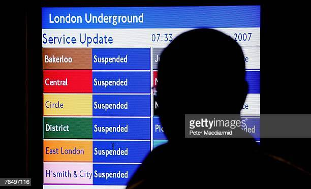 Man looks at an electronic display at Temple Underground Station showing the names of some of the closed lines on September 4, 2007 in London....