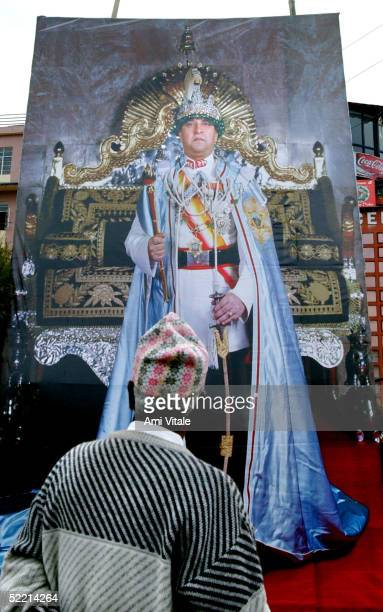 Man looks at an enormous poster of King Gyanendra on Democracy Day February 18, 2005 in Kathmandu, Nepal. Nepal marked its annual Democracy Day under...