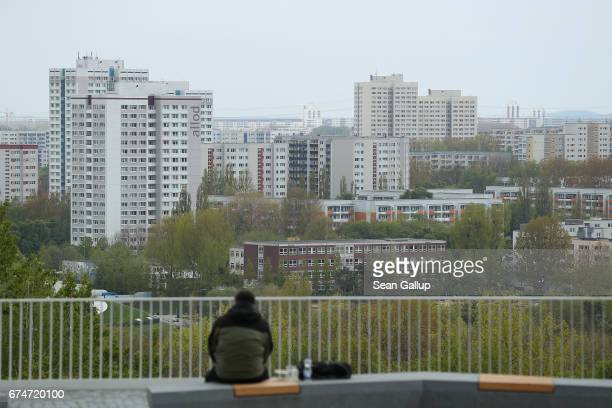 Man looks at apartment buildings built in east Berlin under communist rule in Marzahn district on April 28, 2017 in Berlin, Germany. Property prices,...