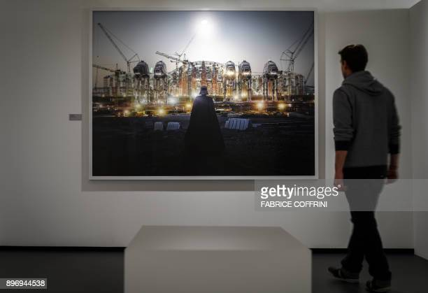 A man looks at 'ATAT Vador' digital photography by French artist Cedric Delsaux at science fiction museum The Maison d'Ailleurs during the exhibition...