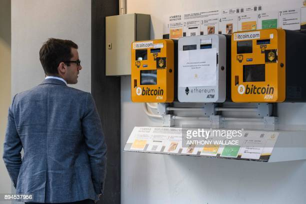 A man looks at ATM machines for digital currency Bitcoin in Hong Kong on December 18 2017 Bitcoin has soared in recent weeks breaking numerous...