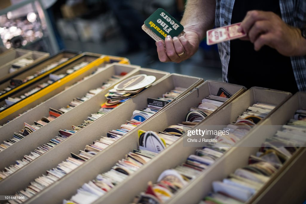 A man looks at beer mats for sale during the Great British Beer Festival at Olympia Exhibition Centre on August 10, 2018 in London, England. The five day festival showcases over 900 real ales and craft beer and is organised by Campaign for Real Ale group CAMRA.