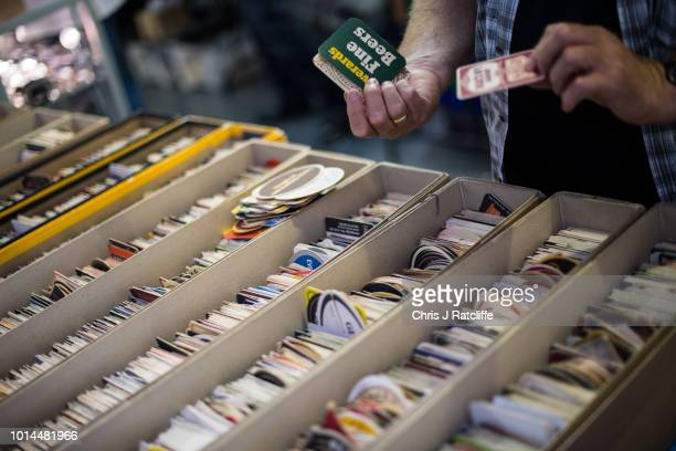 A man looks at beer mats for sale during the Great British Beer Festival at Olympia Exhibition Centre on August 10 2018 in London England The five...