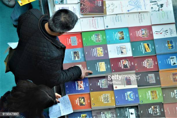 A man looks at books in front of a stand during the 12th International Ankara Book Fair in Ankara Turkey on February 17 2018