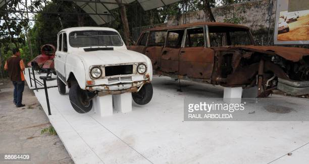 STORY A man looks at cars which belonged to drug trafficker Pablo Escobar inside the Napoles ranch thematic park in Puerto Triunfo municipality...