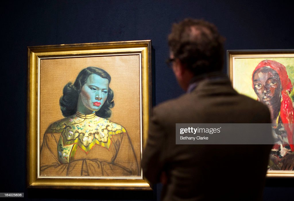 A man looks at 'Chinese Girl' by Tretchikoff on March 19, 2013 in London, England. 'Chinese Girl' is the most iconic work by Vladimir Tretchikoff and is said to be the most widely reproduced and recognisable picture in the world. The picture will be sold at Bonhams South African art sale on March 20, 2013 for an estimated 400,000 GBP.