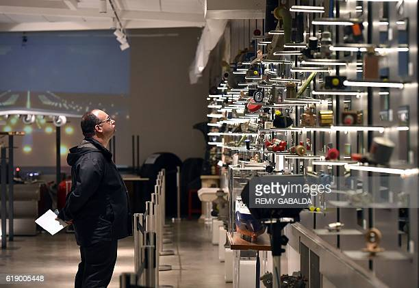 A man looks at Concorde objects exhibited at the Saint Aubin Auction House in Toulouse on October 28 ahead of an auction of Concorde items as...
